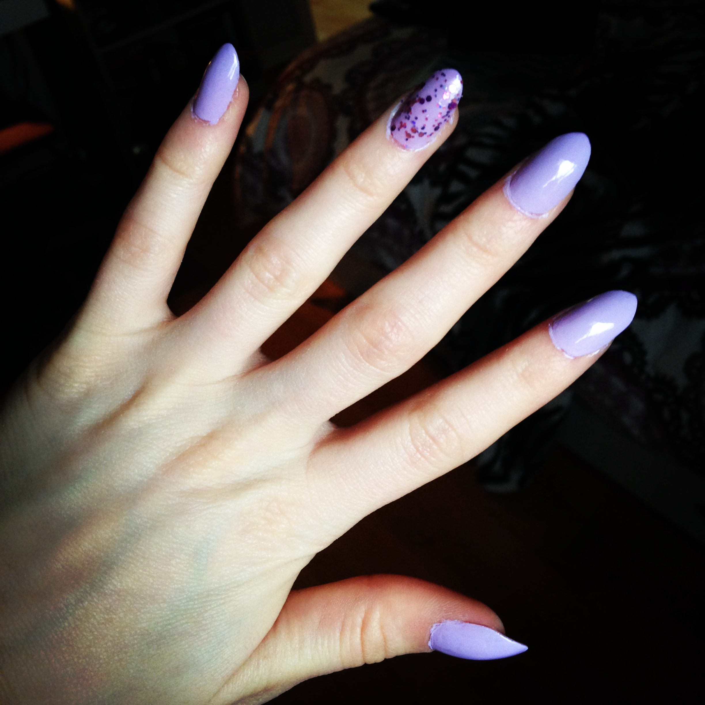 here are my nails of the week one of my real nails broke this week so    Light Purple Stiletto Nails